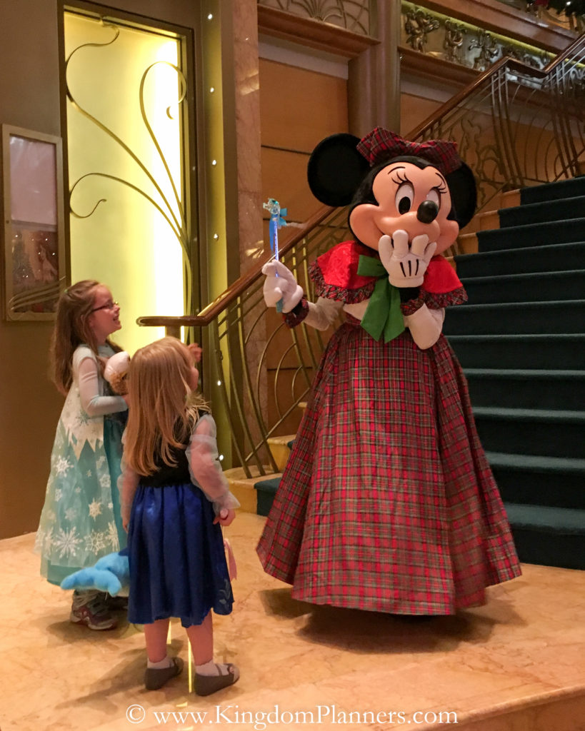 This is a special moment with Minnie when she borrowed my daughter's Elsa wand and played with it.